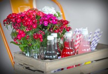 wooden crate with flowers and drinks