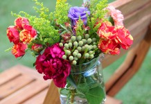 Hanging jars with flowers closeup