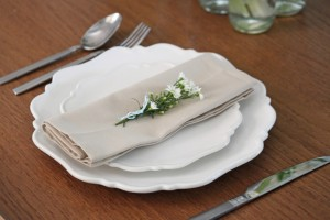Scalloped plates with napkin
