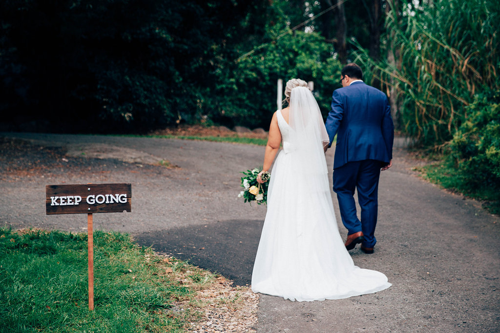 Lisa and Jason. Married at Summergrove Estate. Sign by Lovestruck Weddings.